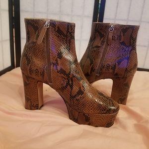 Schutz Snakeskin leather platform boots.